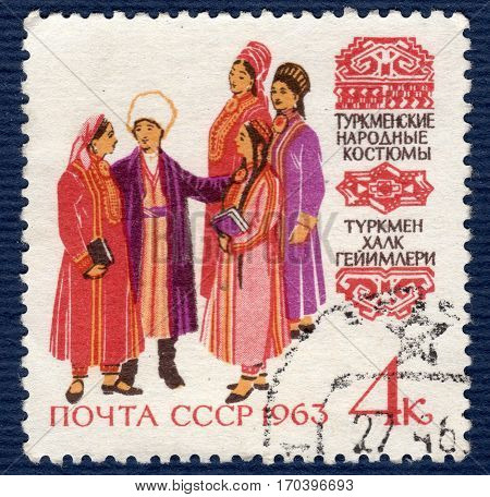 USSR - CIRCA 1963: Postage stamp printed in USSR shows image of musicians and dancers in Turkmen traditional and historic regional costumes, from the series