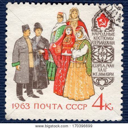 USSR - CIRCA 1963: Postage stamp printed in the USSR  with a picture women and a man in azerbaijan folk costumes,  from the series