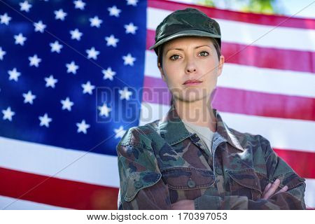 Portrait of soldier standing in front of american flag
