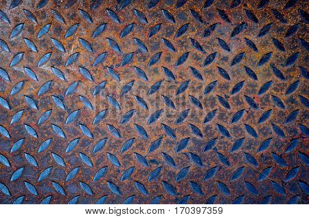 Background of old metal diamond plate with Rusted.