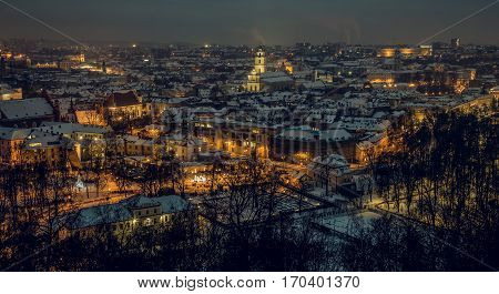 Vilnius old town panorama at night. Vilnius Aerial panorama of the Old Town. Night panorama of the Vilnius Old Town from Hill of Three Crosses Lithuania. Vilnius winter aerial panorama of Old town.