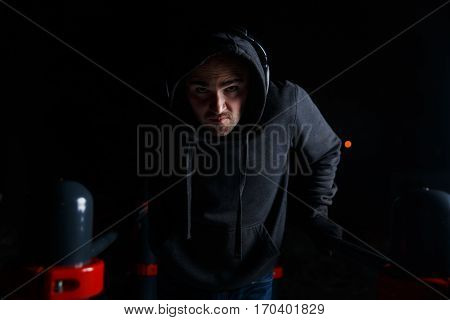 Photography of young man in headphones workout on street