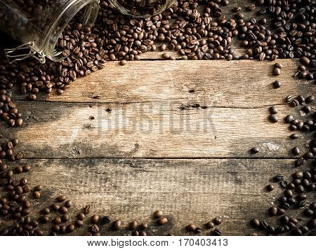 Coffe Beans On The Grunge Wood Background.