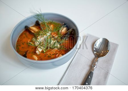 food, new nordic cuisine, culinary and cooking concept - seafood soup with fish and blue mussels in bowl