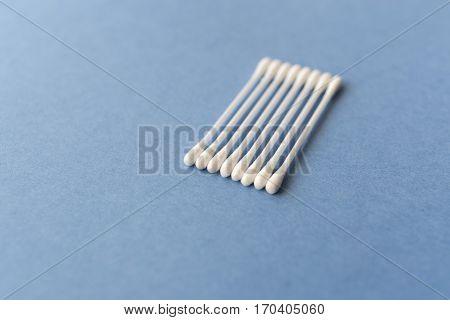 cotton swabs and sponge. Hygiene. Blue texture