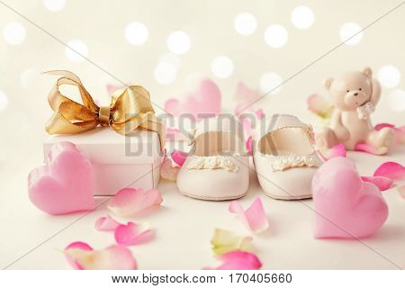 close-up of baby shoes and gift box