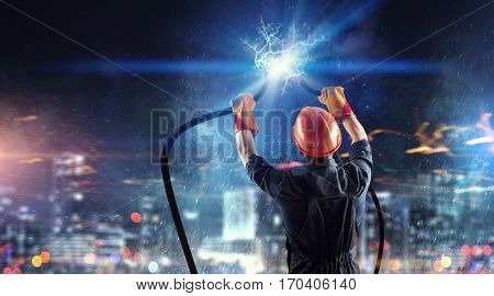 Electrician connecting cable . Mixed media