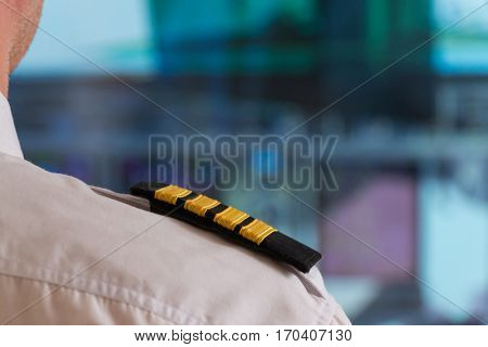 Close up of captain's epaulettes in the cockipt of commercial airplane