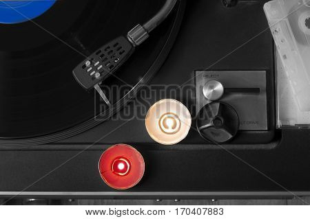 Vinyl turntable and candles on the top of it concept of music and romantic overhead selective color shot