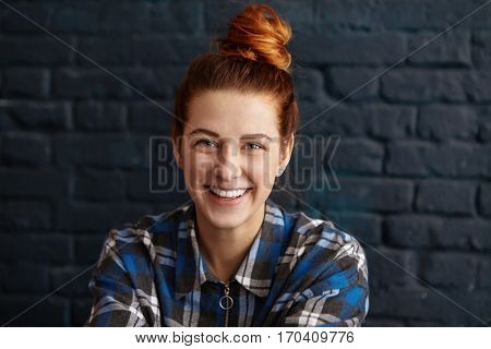 Beautiful Young Redhead Female With Hair Knot Wearing Blue Checkered Shirt Looking At Camera With Cu