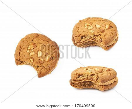 Peanut butter homemade cookie with a bite taken of it, composition isolated over the white background, set of three different foreshortenings