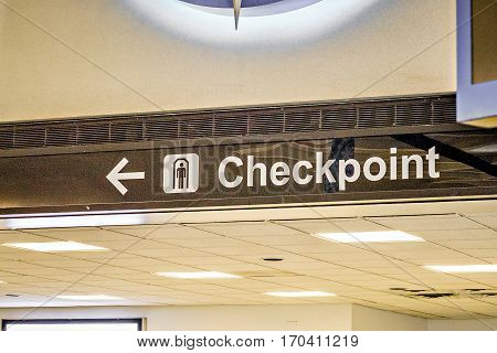an airport direction and a checkpoint sign