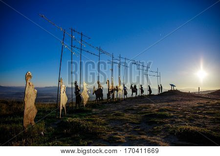 Silhouettes of pilgrims on the mountain on the way of St. James