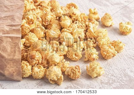 Popcorn bag on the table. Sweet caramel popcorn