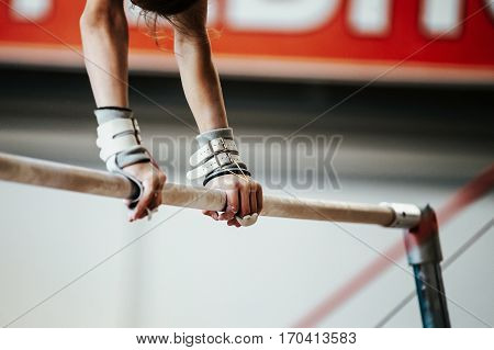hands young girl gymnast exercise on uneven bars poster