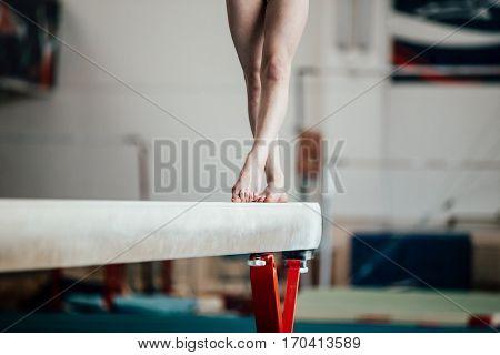 feet young girl athlete gymnast on balance beam