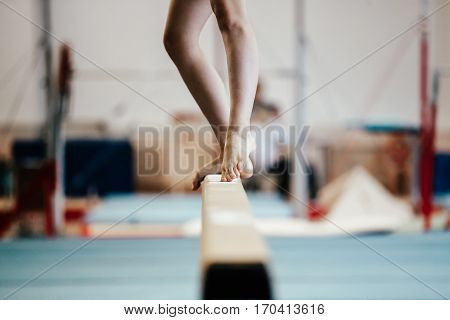 competition gymnastics exercises on balance beam girl gymnast