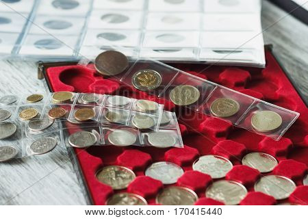 Collector's Coins In The Box For Coins And Page With Pockets