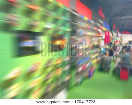 De focused/blurry background of Sports clothing store in Inter Sport storeBlur of city shopping people crowd at marketplace shoe shop abstract backgroundfor use as a background