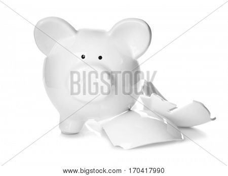 Broken piggy bank on white background