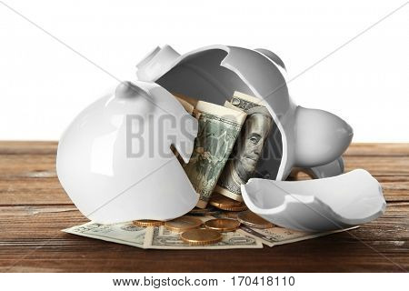 Broken piggy bank with money on white background