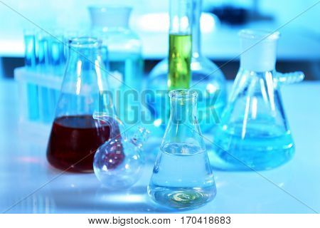 Chemical glassware with samples on table at laboratory