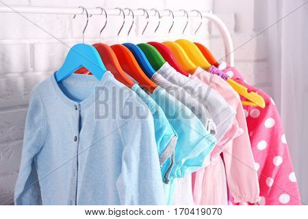 Children clothing on hanger stand in dressing room