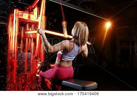 Young Fitness Woman Doing Exercises The Major Muscle Groups In The Gym. Strength Training. Fiery Tra