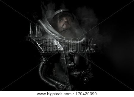 Technology, Space man, astronaut dressed in silver or metalized space suit. Armed with a laser gun and surrounded by smoke