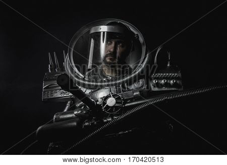 Cyborg, Space man, astronaut dressed in silver or metalized space suit. Armed with a laser gun and surrounded by smoke
