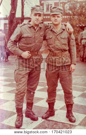PIESZYCE, POLAND, CIRCA 1970's: Vintage photo of two soldiers outdoors