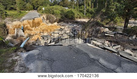 Road washed out after Hurricane Matthew in Raeford North Carolina