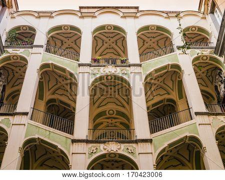 Scenographic courtyard staircases of Palazzo dello Spagnuolo, Rione Sanità, Naples, Italy