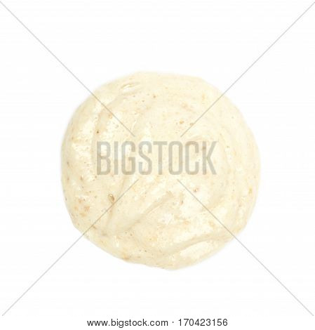 Puddle of the mashed banana puree isolated over the white background