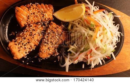 Grilled Salmon with fresh salad. Japanese food.