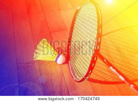 Close up badminton rackets and shuttlecock on  court