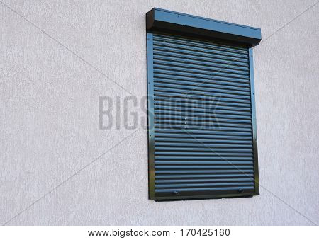 House Window with rolling shutter installation. Rolling Shutter.