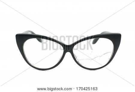 Pair of black plastic sight glasses with the broken lens glass, composition isolated over the white background