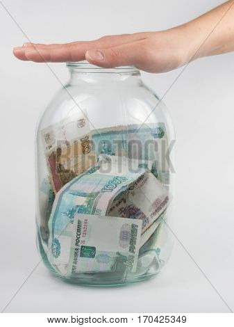 Hand Covered The Three-liter Jar With Russian Money