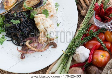 Black Spaghetti Alle Vongole. Black Seafood Pasta With Clams And Yogurt Garlic Sauce Over Black Tabl