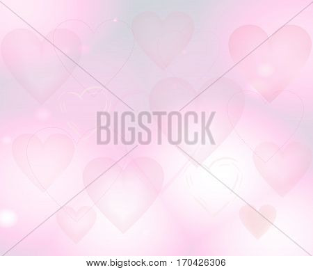 Pale pink background with hearts. Light blur backdrop.  The Theme of love and Valentines day.
