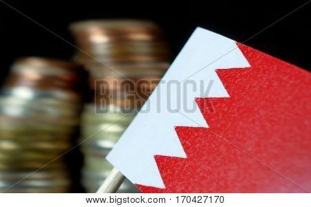 Bahraini Flag Waving With Stack Of Money Coins Macro
