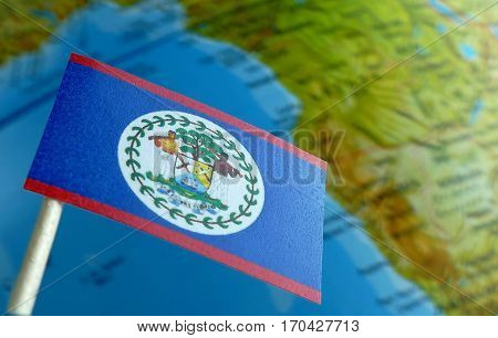 Belize Flag With A Globe Map As A Background Macro