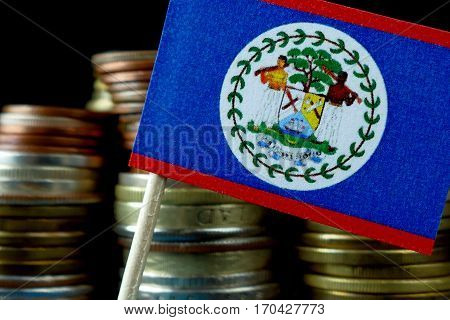 Belize Flag Waving With Stack Of Money Coins Macro
