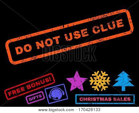 Do Not Use Clue text rubber seal stamp watermark with bonus christmas symbols. Caption inside rectangular shape with grunge design and unclean texture.