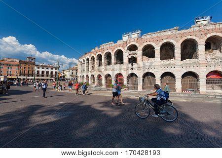 VERONA ITALY- September 09 2016: Tourists are near Verona Arena on Piazza Bra in Verona