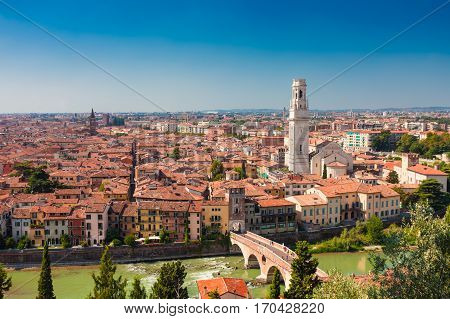 VERONA ITALY- September 09 2016: Panorama of city Verona Italy. Scenery with Adige River Bell towers of churches tile roofs of old houses and the embankment of Adige River.