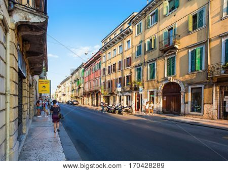VERONA ITALY- September 08 2016: People are waiting a bus on the bus stop on the street in the city center of Verona