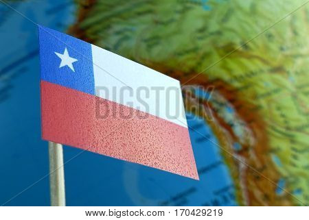 Chilean Flag With A Globe Map As A Background Macro