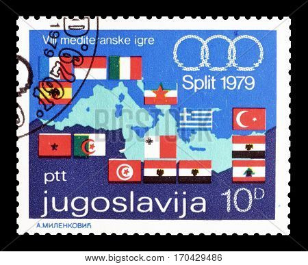 YUGOSLAVIA - CIRCA 1979 : Cancelled postage stamp printed by Yugoslavia, that shows Mediterranean games logo, map of Europa and flags.